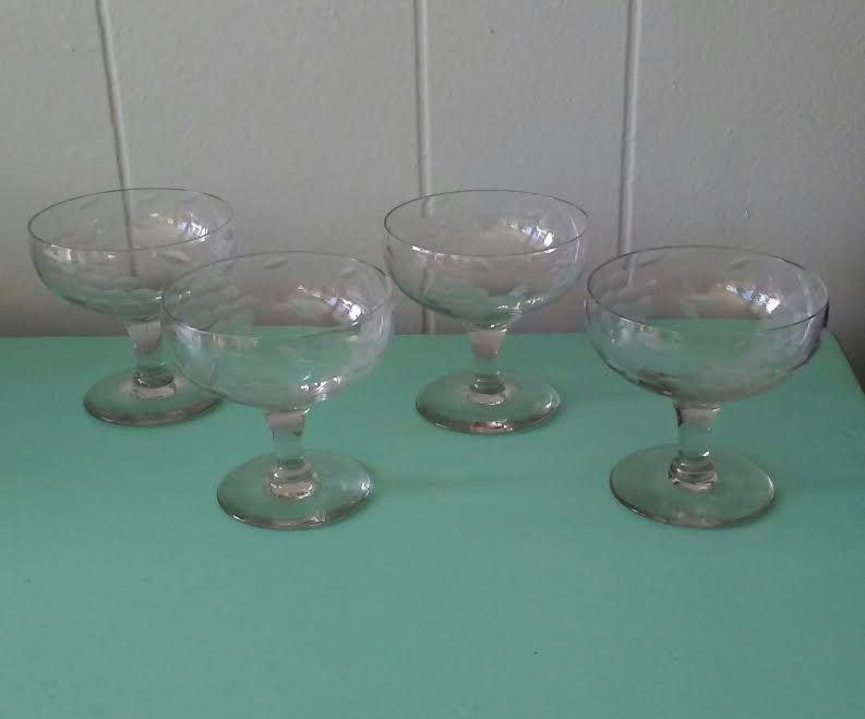 7e7bb8dc64b6 Beautiful set of four(4) vintage champagne glasses. Lovely grape cluster  design on these coupe glasses. Smoked gray hue to this etched champagne  glass set.