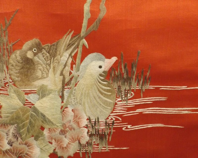 Ducks on tranquil pond with embroidery flowers scroll for