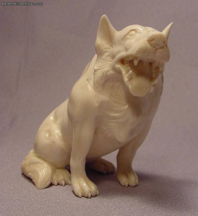 Rare fierce carved ivory large wolf like netsuke for sale