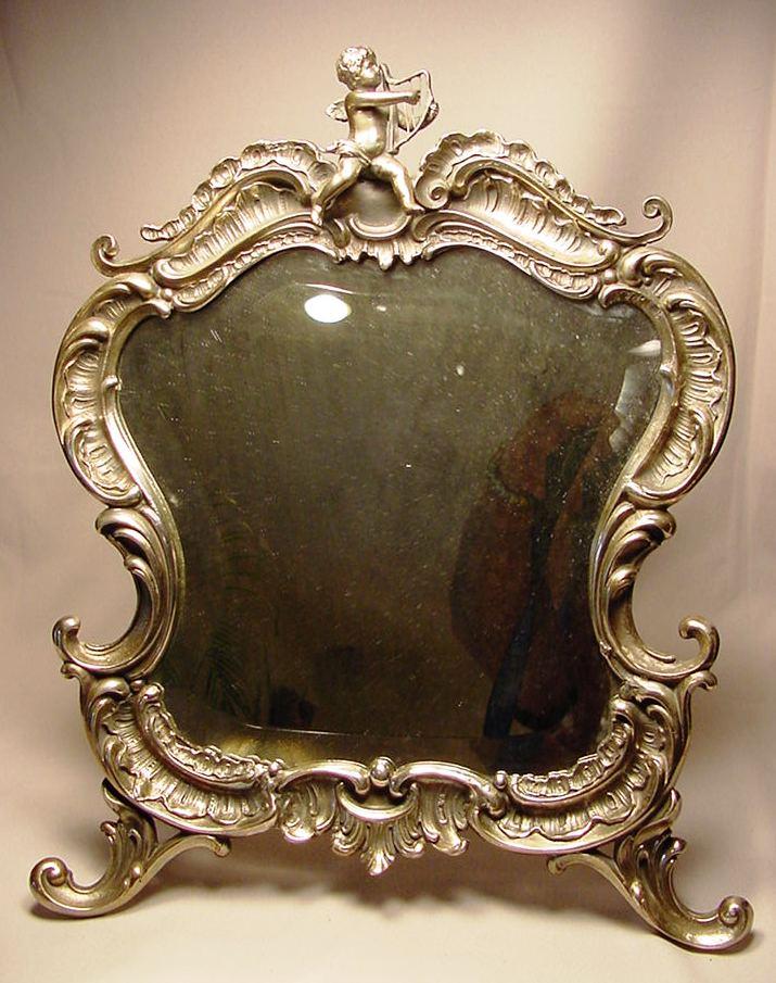 Exquisite antique silver plated cherub mirror for sale for Silver mirrors for sale
