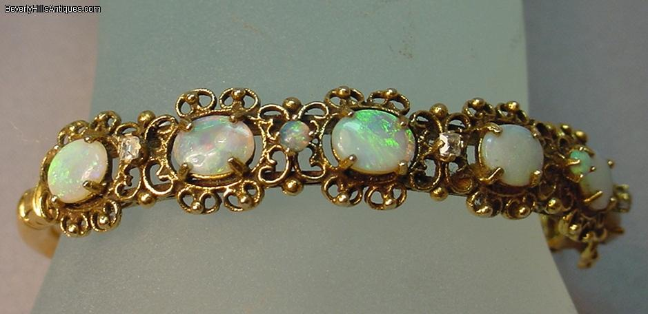 8a9a727a51e3b Beautiful vintage antique Art Deco marked 14k opal and diamond bracelet.  The bracelet is set with 4 old cushion cut diamonds and 8 natural fiery  opals.