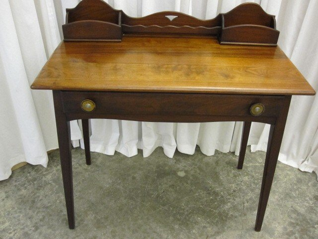 We have for sale a very nice walnut ladies writing desk. The desk has slots  on top for stationery and accessaries. There is a full length drawer. - Antique Small Walnut Ladies Writing Desk W Paper Slots For Sale
