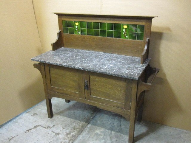 We have for sale a great looking piece from Europe. I do not know what  country it came from. It is a sideboard server or work cbinet. - Antique European Marble & Tile Sideboard Cabinet For Sale