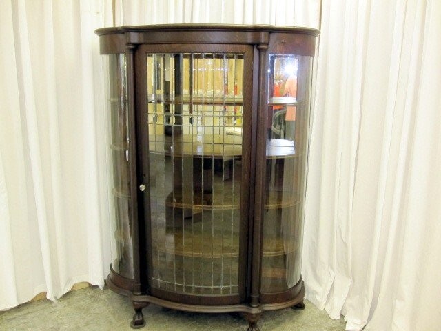 We have for sale an antique china cabinet. The cabinet has a wide lead  glass door that opens to 4 wood shelves. The back has two mirrors. - 1800's Lead Glass China Cabinet W Curve Glass Sides For Sale