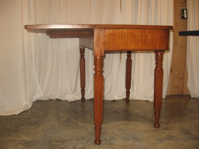 We Have For Sale An Antique Server Or A Library Table. The Maple Table Has  A Center Drawer On One Side With A Drop Leaf On The Other Side.
