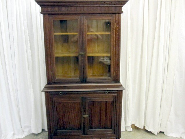 We have for sale a mission arts & crafts kitchen stepback china cabinet or  hutch. The dark walnut two piece hutch is in great condition. - Antique Dark Walnut Arts & Crafts China Cabinet Hutch For Sale