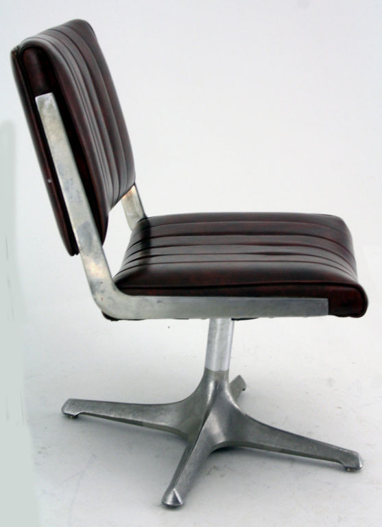 american instutional swivel chair in brushed aluminum and vinyl for