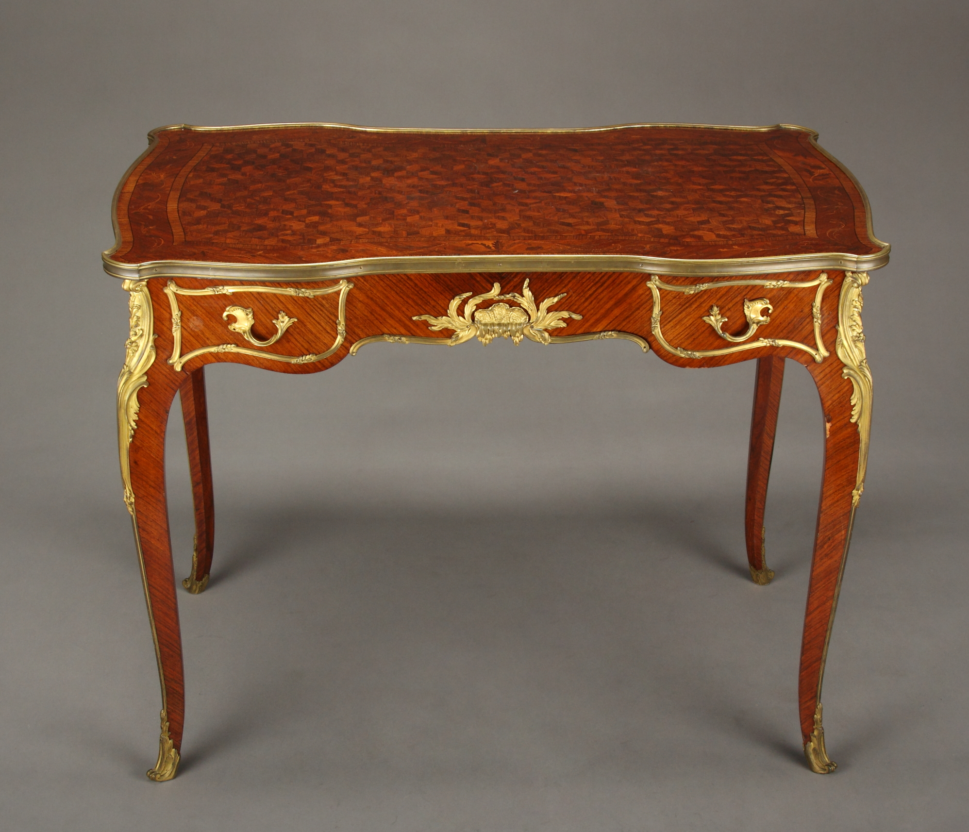 A 19th century french louis xv style burea plat by for Furniture in french