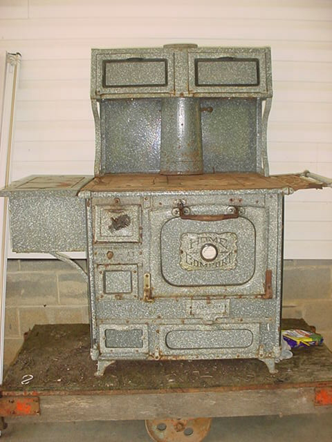 Early 1900\'s Home Comfort Wood Stove in excellent condition. Original  enamel stove pipe, clean out rod and stove eye lifter. Copper lined water  tank. - Home Comfort Antique Wood Stove For Sale Antiques.com Classifieds