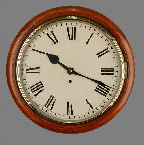a mahogany circular wall clock for sale