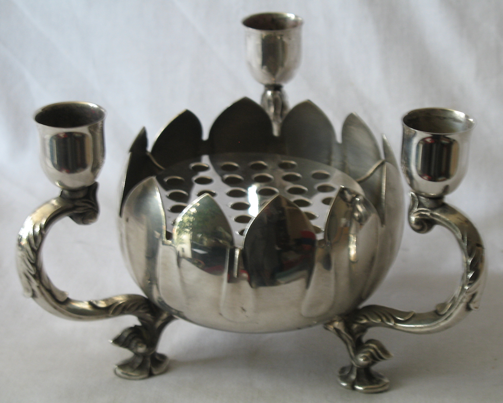 a vintage art deco silver plate centre piece in the shape of a flower having 3x candle holders. Black Bedroom Furniture Sets. Home Design Ideas