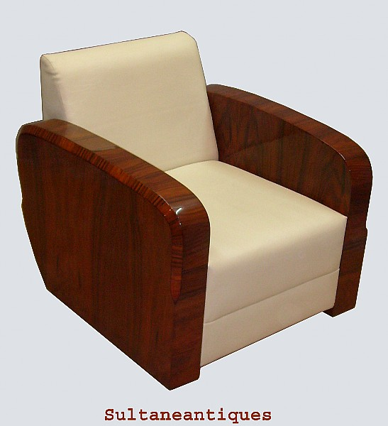 magnificent classic art deco style rosewood chair with rounded and carved edges and seat upholstered with white faux leather art deco style rosewood