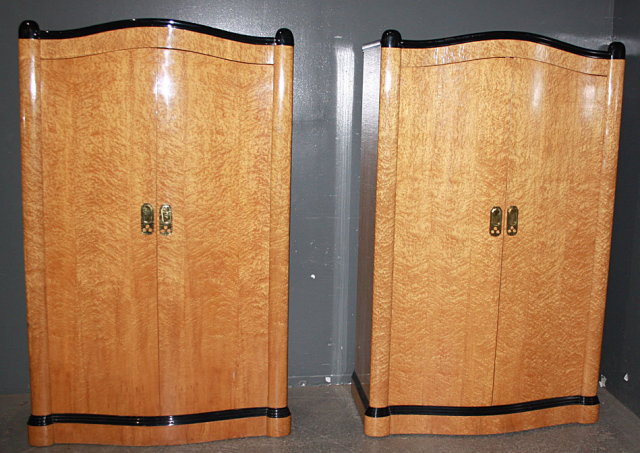 Look at the gorgeous birds eye maple and the elegant contrasting ebonized  black lacquer trim. - RARE PAIR FRENCH BIRDS EYE MAPLE ART DECO ARMOIRES For Sale