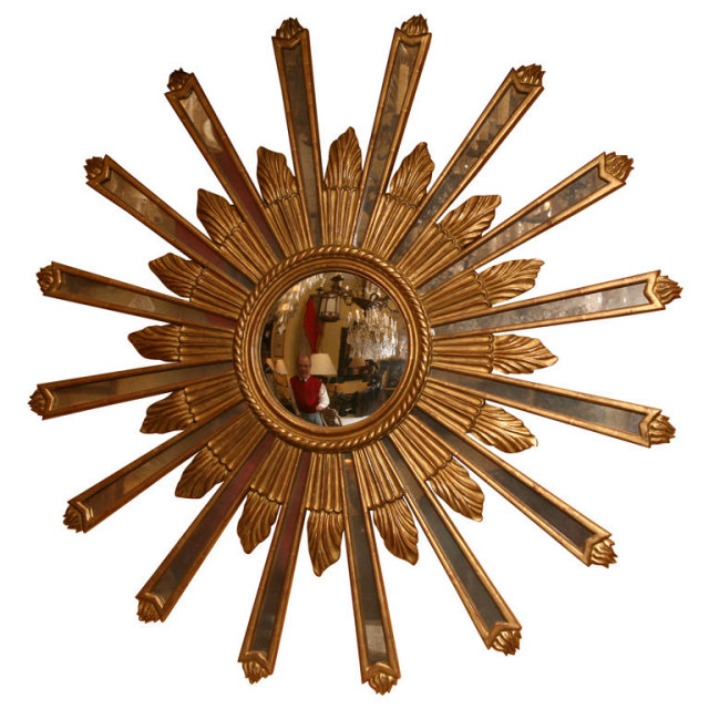 A Carved Gold Leaf Wooden Sun Burst With Convex Mirror In The Center Antiqued Radiating From Framed Wood