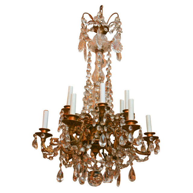 A 19TH CENTURY 12 LIGHT BRONZE AND CRYSTAL CHANDELIER For