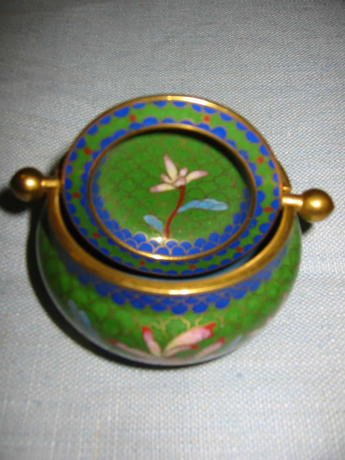 Asian green roll top cloisonne covered bowl decorated lotus flowers it has gorgeous flower medallion decorated enameled on brass with two handles it has incredible craftsmanship izmirmasajfo
