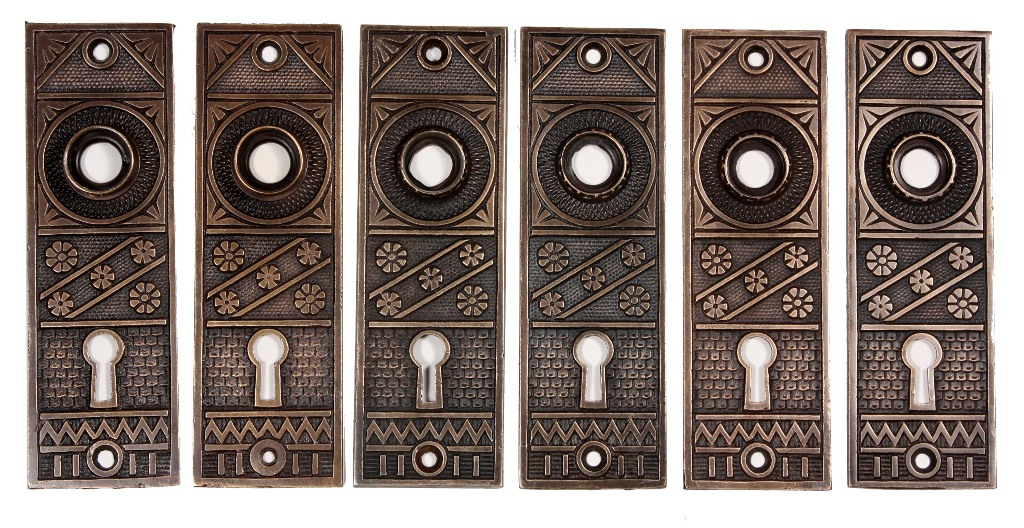 these are three matching complete sets of antique cast bronze door hardware by fc linde featuring a fiveflower design and including the door knobs