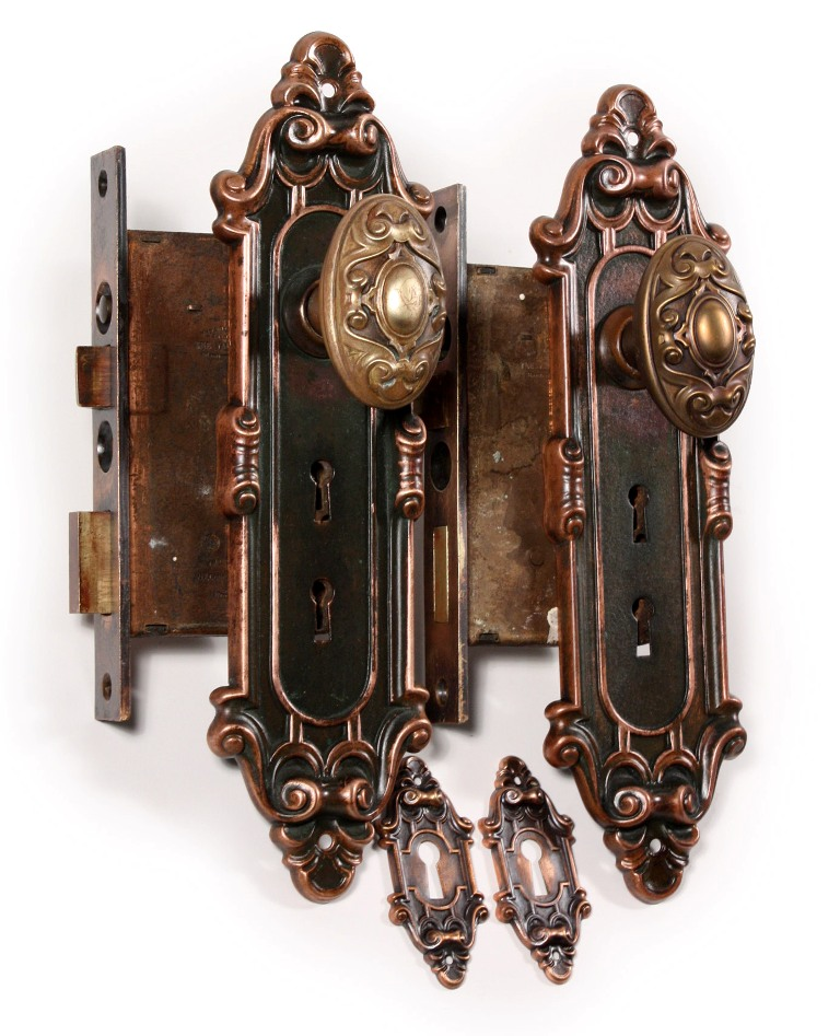 Two matching antique bronze entry door hardware sets for Entry hardware