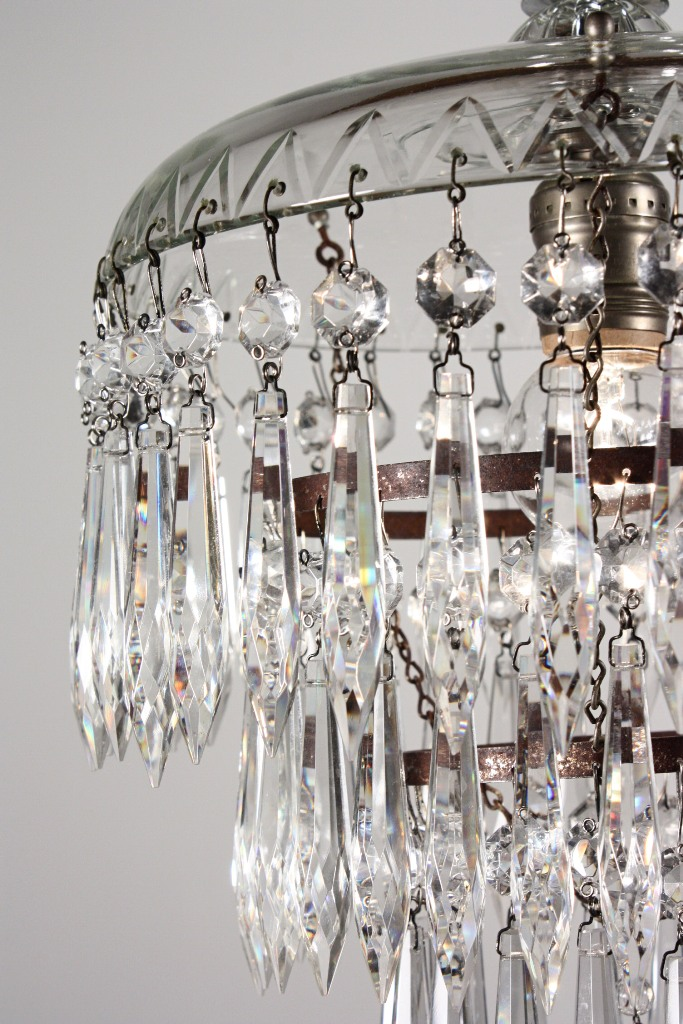 """A charming antique small tiered chandelier with icicle prisms, dating from  the 1930's. This one-light """"wedding cake"""" chandelier descends in a chain to  a ... - Petite Antique Three-Tier Crystal Chandelier With Glass Prisms"""