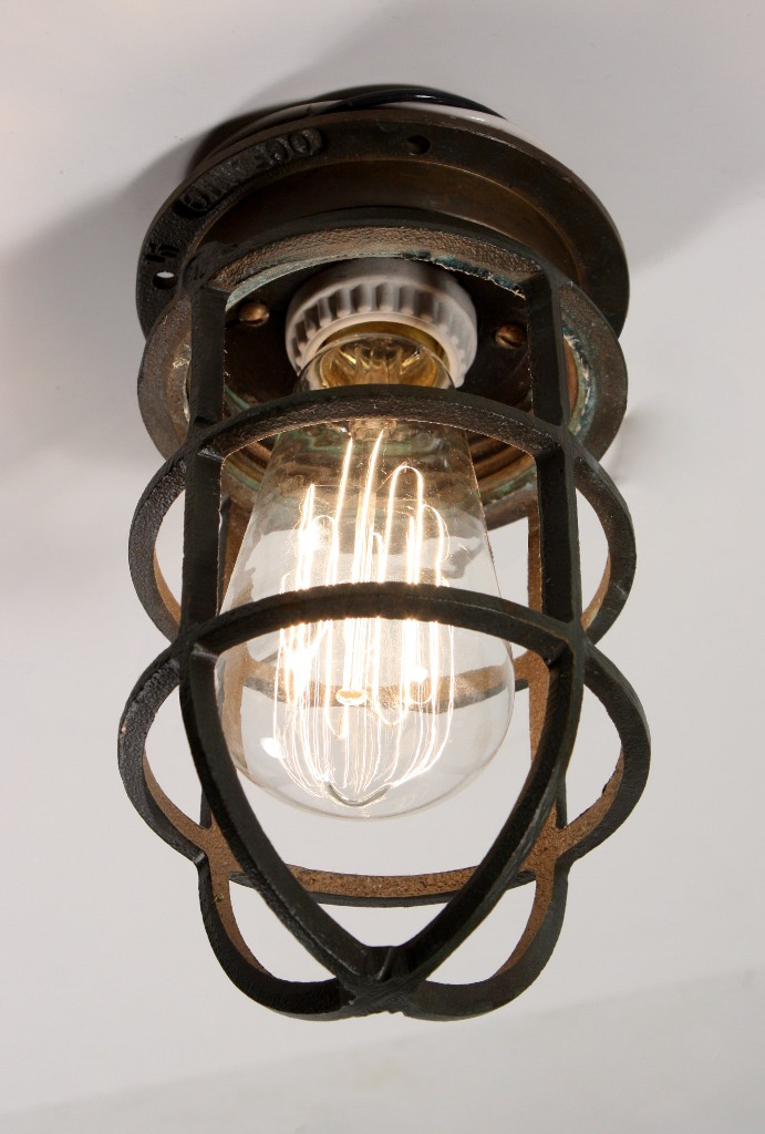 Antique industrial cast bronze cage light fixture for wall or an antique cast bronze industrial cage light fixture designed for use either as a sconce or a flush mount light this fixture is signed oceanic mozeypictures Images