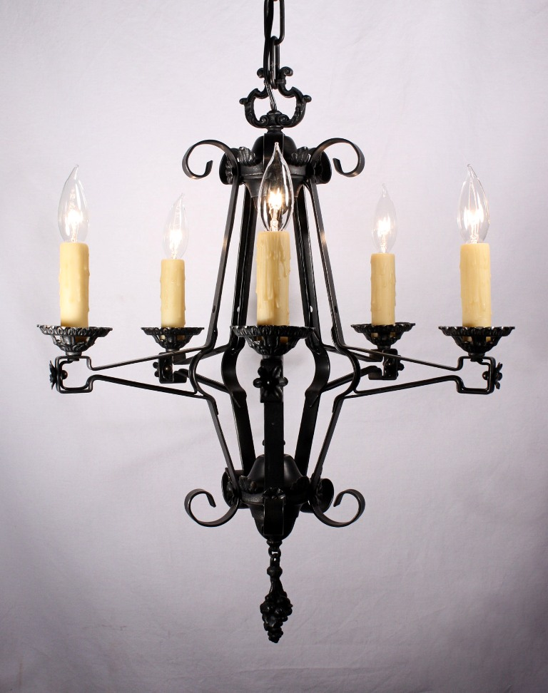 Bold antique spanish revival five light iron chandelier for Spanish revival lighting