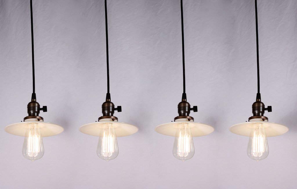 four matching antique industrial pendant lights with milk glass