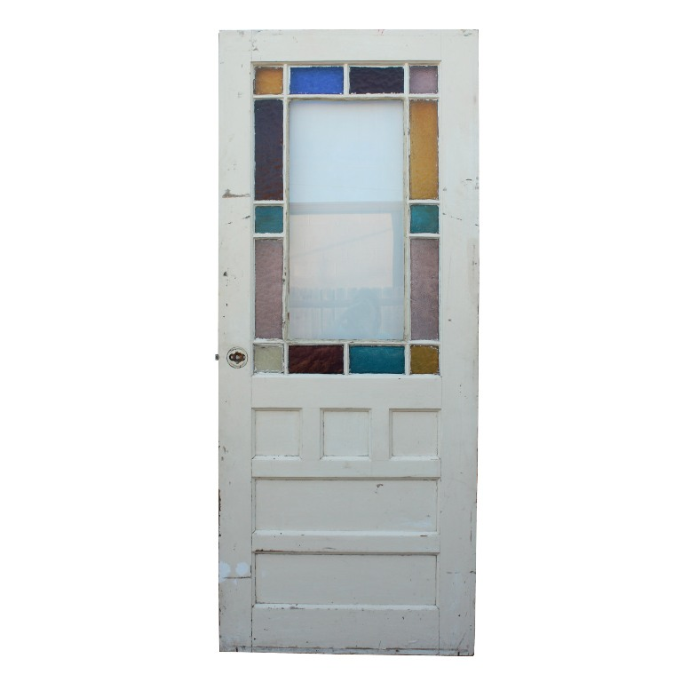 "A gorgeous reclaimed antique 32-inch door with carved pinwheels or  sunbursts, dating from the 1880's and featuring a stained glass border. - Wonderful Salvaged 32"" Eastlake Door With Stained Glass, Carved"