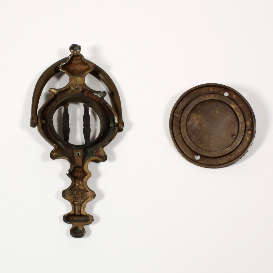 This is an antique bronze door knocker with a round speakeasy made by the  A.C.M company and dating to the first part of the 20th century. - Antique Bronze Door Knocker With Round Speakeasy, Early 1900's, NSE2
