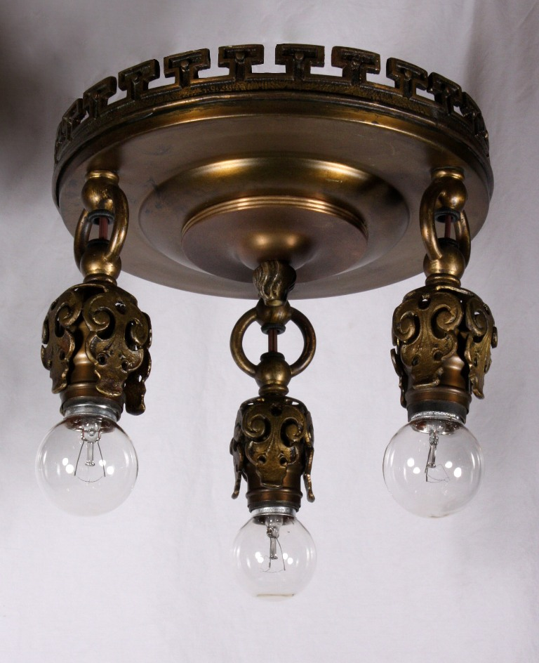 four matching antique neoclassical three light flush mount