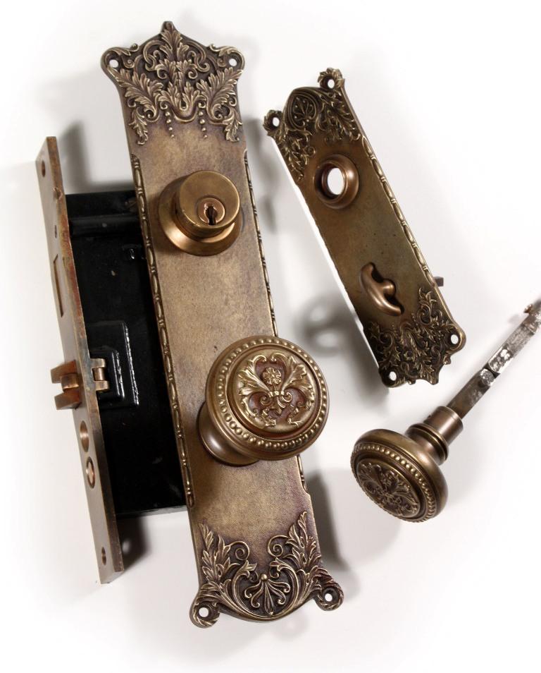 "A stunning antique entry cast bronze door hardware set in P. & F. Corbin's  ""Tivoli"" pattern, featured in the 1905 Corbin catalog. - Antique Cast Bronze ""Tivoli"" Complete Exterior Door Hardware Set By"
