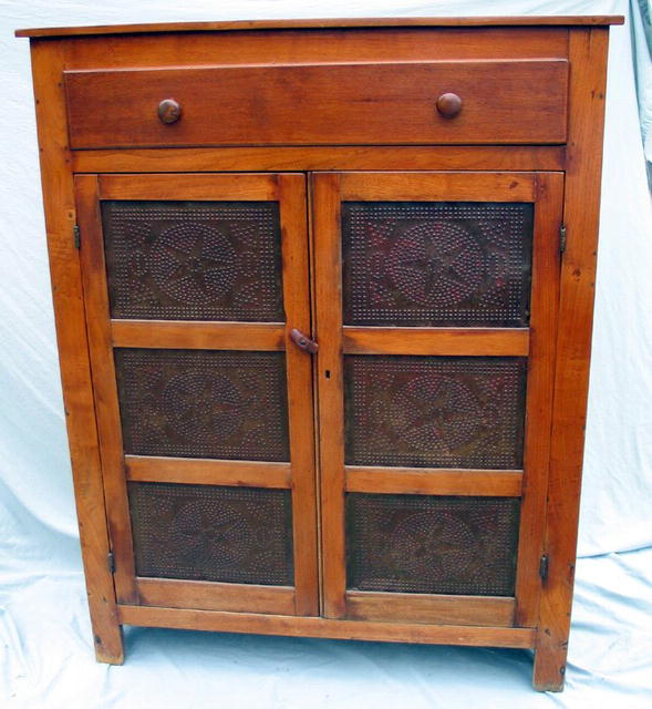 If you want a quality piesafe that is walnut and in superb condition this  one is for you. Circa 1880 and a nearly flawless example. - OUTSTANDING PIE SAFE WALNUT QUALITY TIN STARS WOW! For Sale