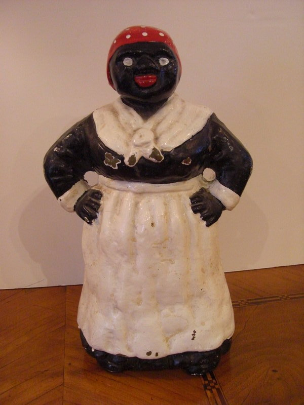 Decorative and very collectible Aunt Jermina Cast Iron Door Stop, Circa  1900. H:12