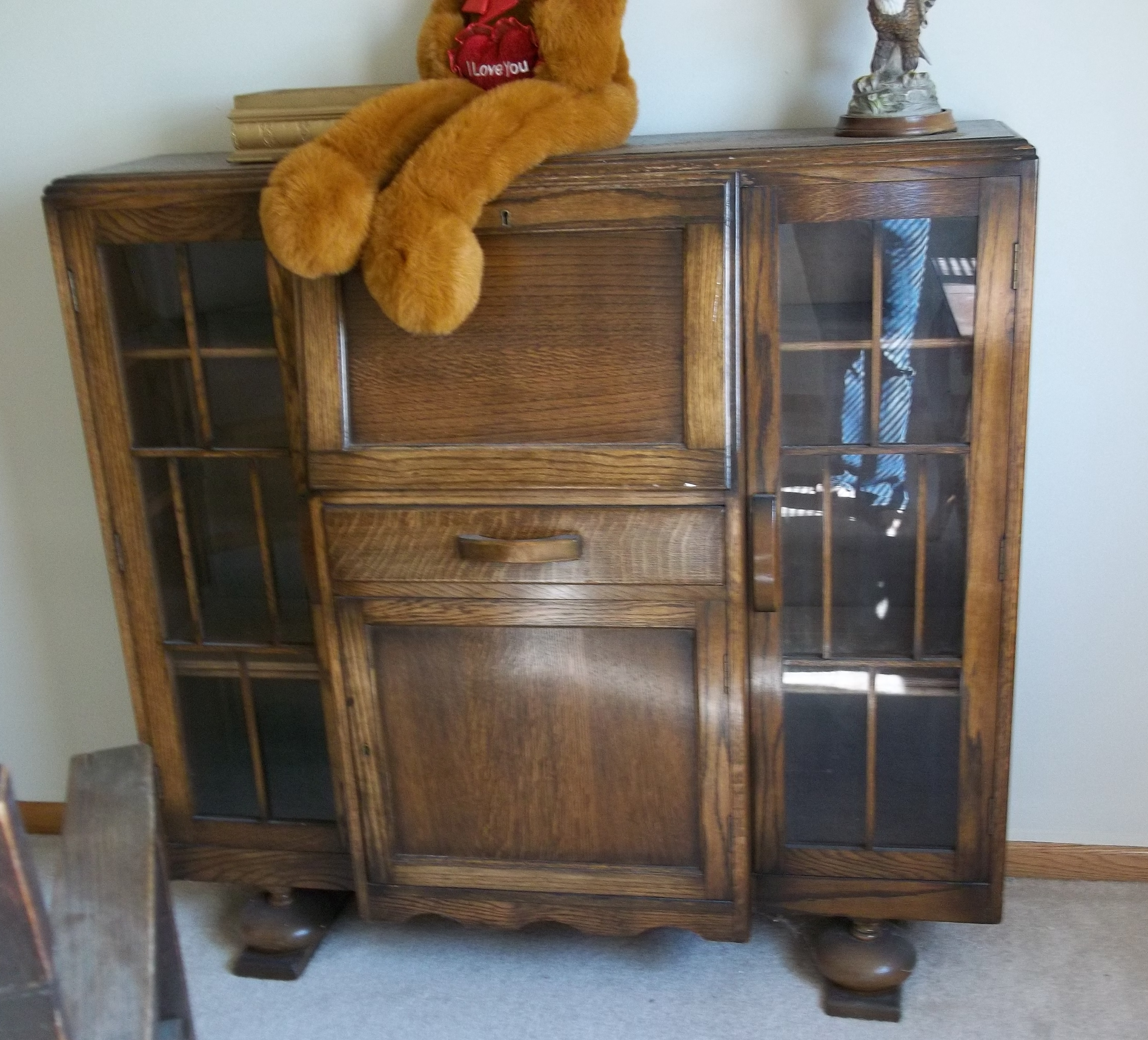 This is a beautiful antique break front secretary desk - bookcase that is  made of oak and dates from