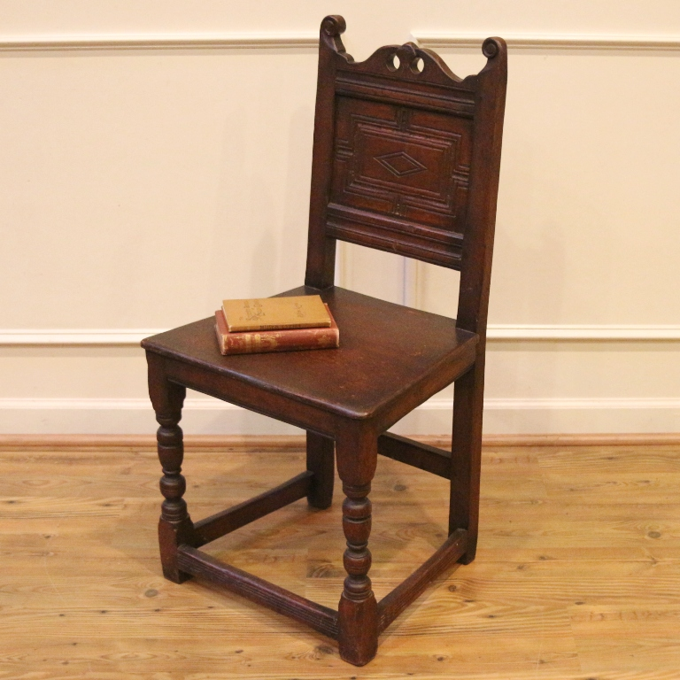 What a fantastic piece of centuries old English history this chair is. - 17th Century Antique English Oak Carved Country Chair. For Sale