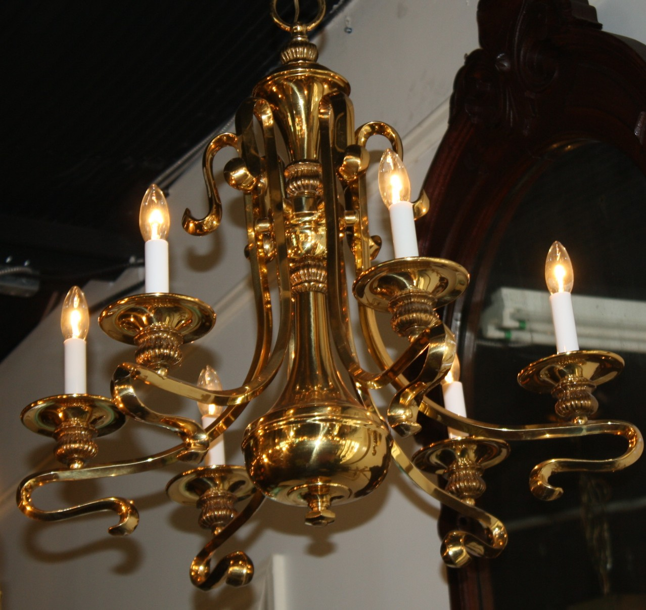 An actually good looking, brass chandelier! Six arms curl and swirl to hold  tall
