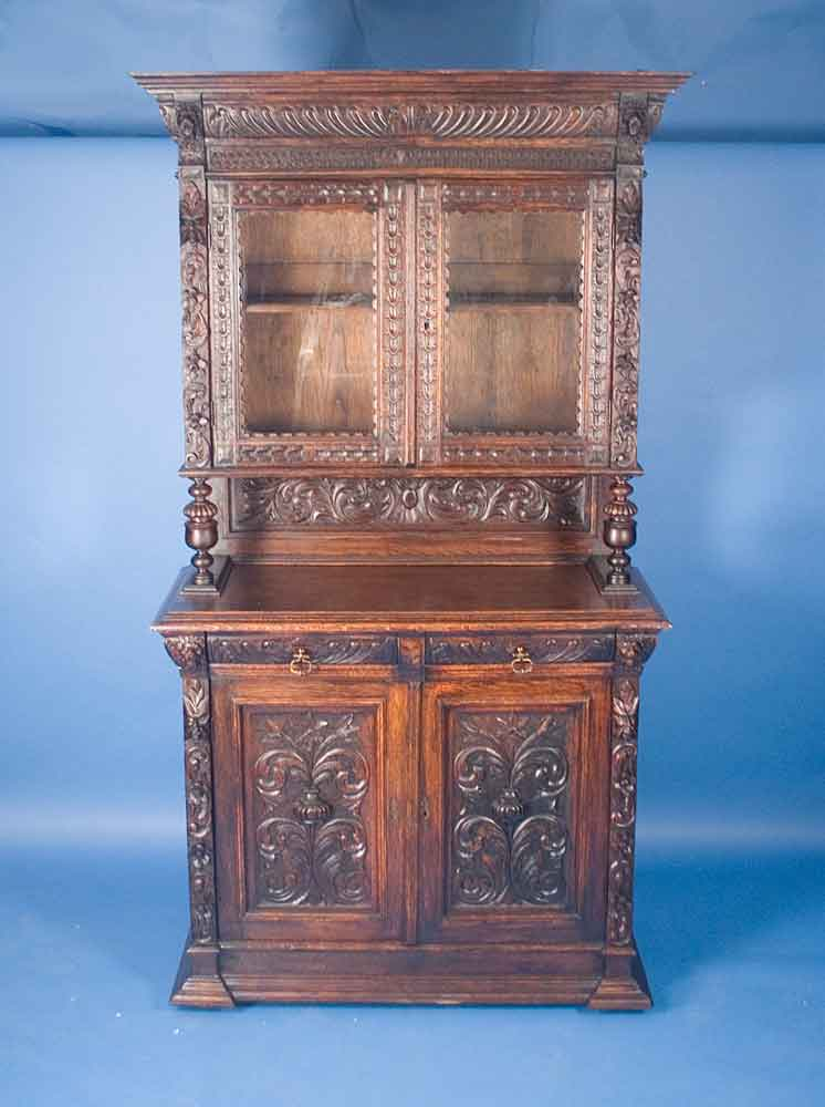 circa: 1900 width: 48.5 height: 91 length: 20.25 This exquisite hand-carved  hunt cupboard was made during the late Victorian period in England. - Antique Carved Oak Victorian Era Hunt Cupboard For Sale Antiques