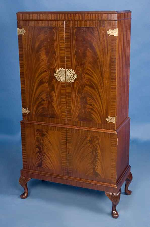 circa: 1960 width: 34 height: 60 length: 17 This elegant mahogany drinks  cabinet was crafted in England around 1960. Today, the flame mahogany  remains as ... - Antique Style Mahogany Drinks Cabinet For Sale Antiques.com