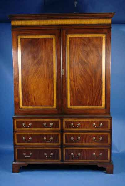 circa: 2000 width: 55 height: 85 length: 24 This gorgeous TV cabinet is  handmade in England using the finest in Georgian furniture style and design. - Antique Style TV Cabinet For Sale Antiques.com Classifieds