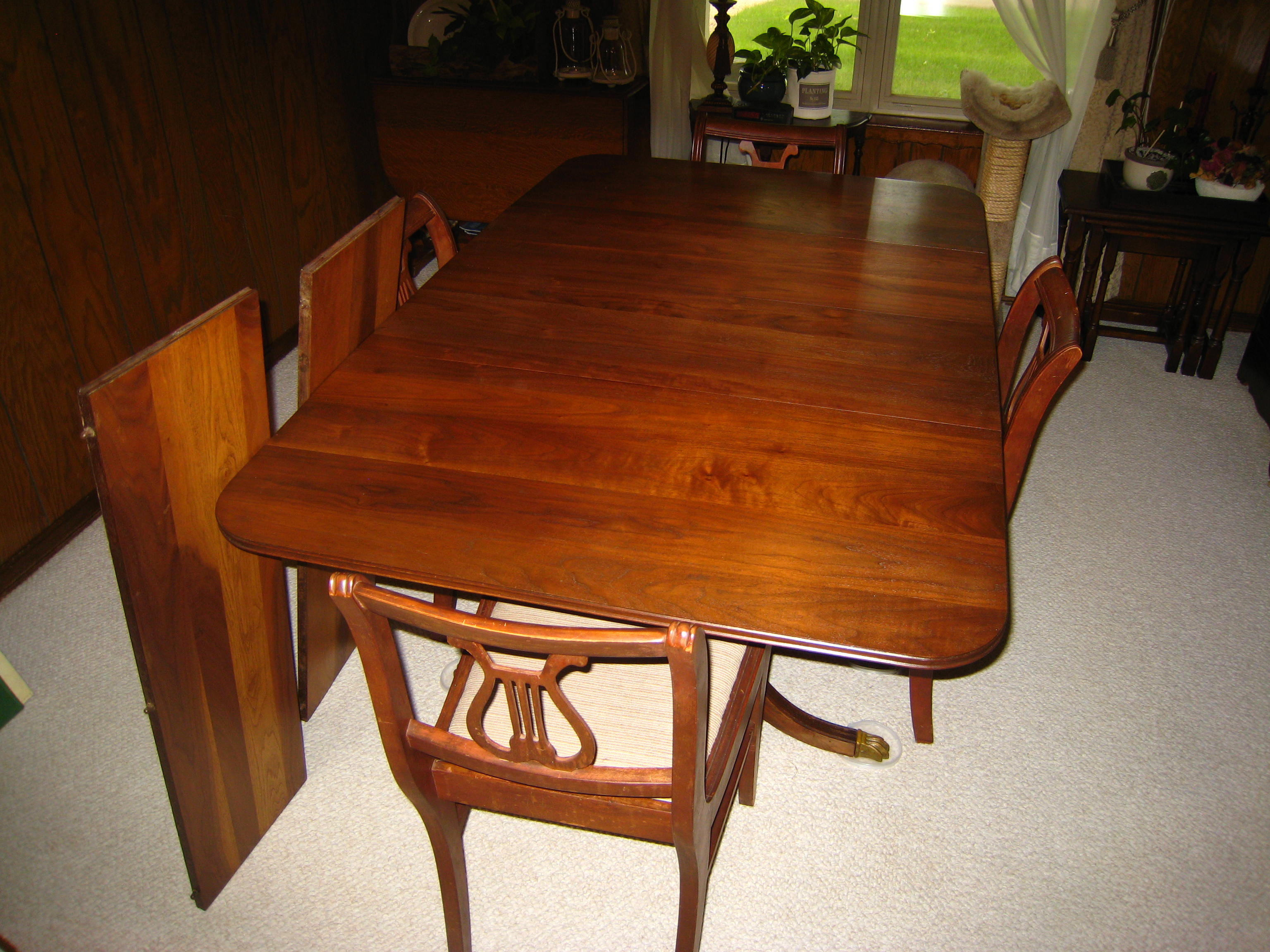 Banded mahogany duncan phyfe style dining table w brass for Styling a dining table