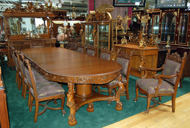 1890 Description:Magnificently Carved 16 Piece Oak Dining Room Set With  Figural Maidens And Winged Cupids Attributed To R.J. Horner.