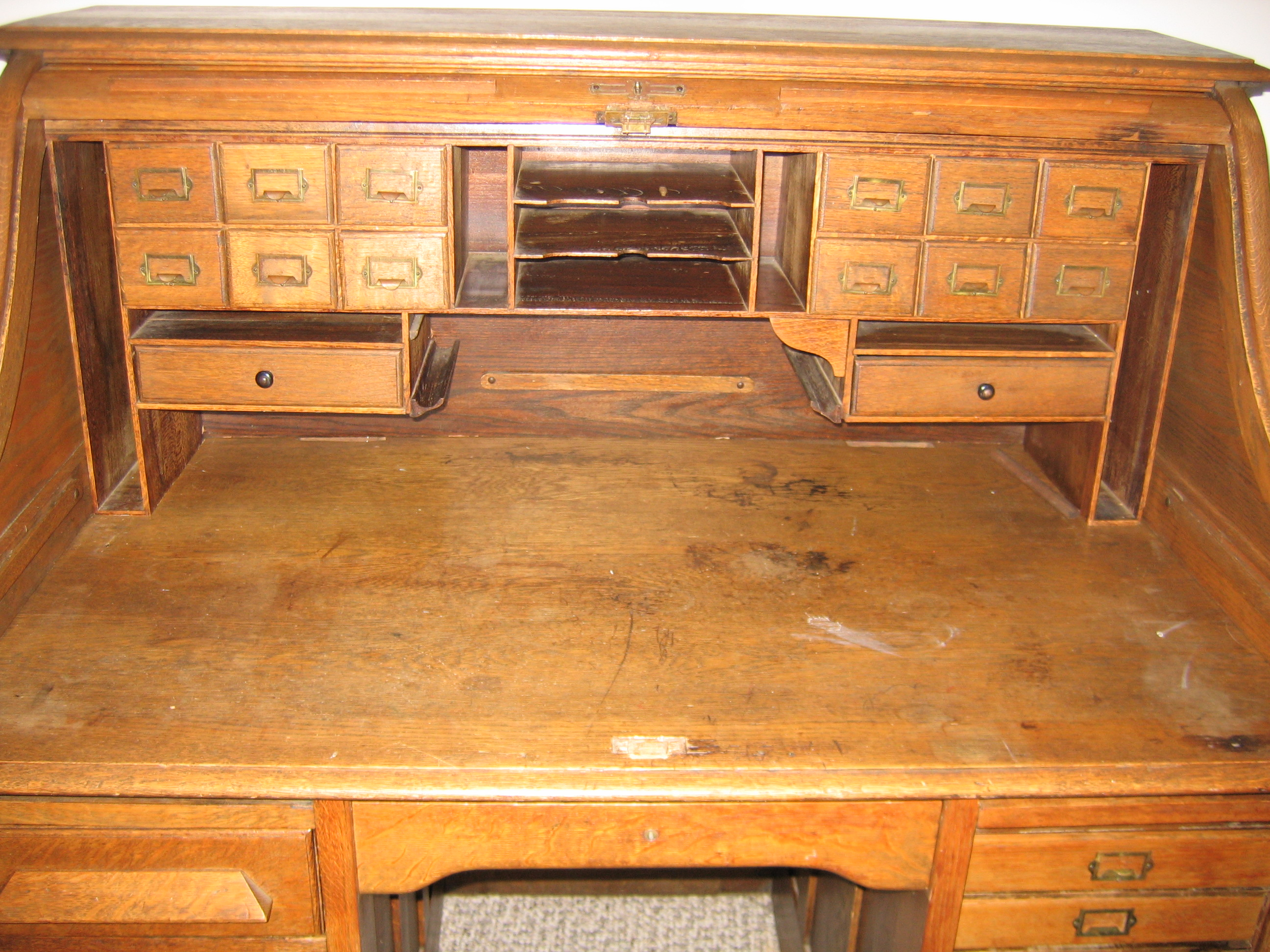 Marvelous photograph of Antique roll top desk in very good condition. All original. with #CA7401 color and 2592x1944 pixels