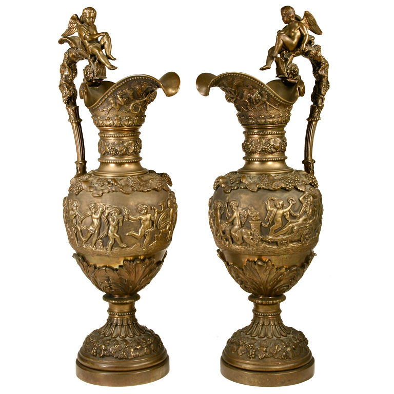 Pair Of Spectacular Brass Bacchanalian Ewers For Sale