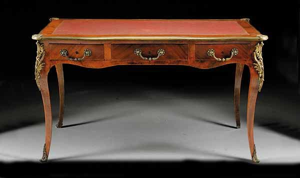Made from beautiful king wood with handsome bronze mountings and hardware.  Original leather top is in very good condition as is the entire desk. - French Antique Writing Desk For Sale Antiques.com Classifieds