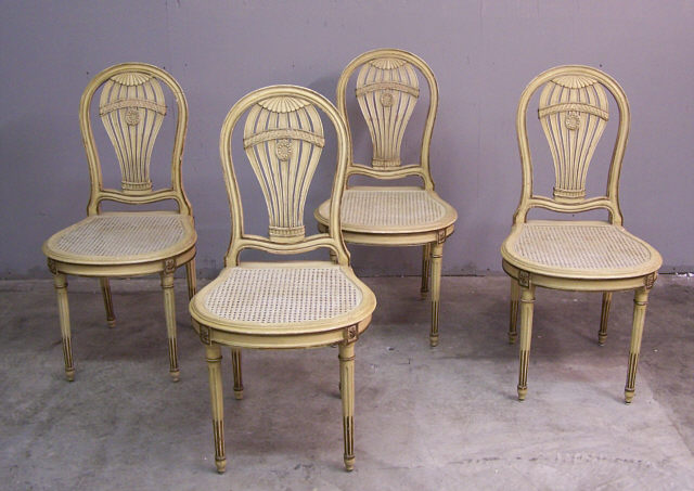 let of four balloon back cane seat chairs c1900. Each chair is hand carved,  retains its original painted surface and has hand woven cane seats. - Set Of Four Balloon Back Cane Seat Chairs C1900 : Item # 6345 For