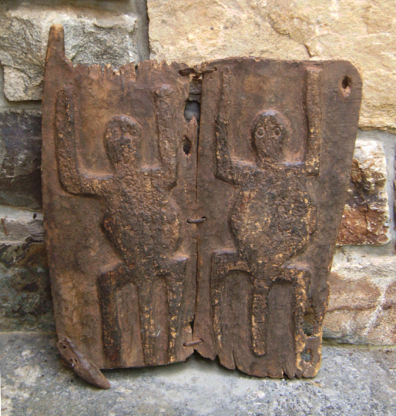 Primitive dogon double door with carvings of turtles