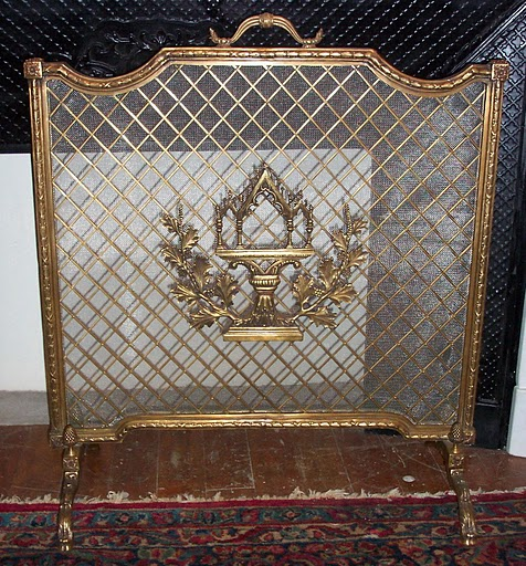 Antique bronze and metal mesh firescreen
