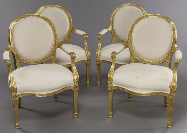 Set Of 4 Louis XVI Style Gilt Wood Arm Chairs, Having Medallion Backs,  Padded Arms And Bowed Seats, Resting On Square Fluted Tapering Legs.
