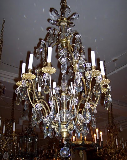 Antique French Bronze and Baccarat Crystal Chandelier. Circa 1880 - 1890.  The dimensions are 42