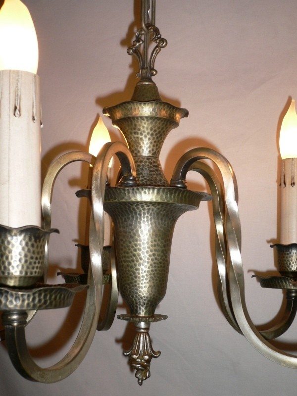 This Light Fixture Supports Five S Curved And Twisted Arms Leading To Scalloped Hammered Wax Pans Candle Cups
