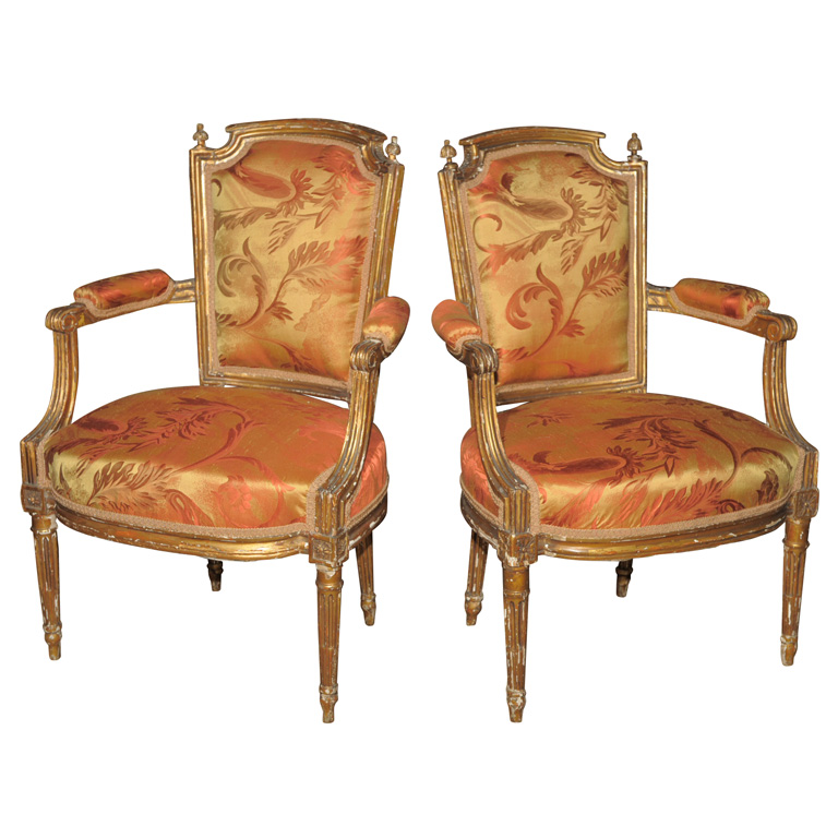FRANCE 19TH CENTURY A PAIR OF 19TH CENTURY GILDED ARMCHAIRS IN THE LOUIS  XVI STYLE WITH  EN CHAPEAU  BACK OVER PADDED OUTSCROLLED ARMS ABOVE AN  UPHOLSTERED  A PAIR OF GILDED LOUIS XVI STYLE ARMCHAIRS For Sale   Antiques com  . Louis Xvi Style Furniture For Sale. Home Design Ideas